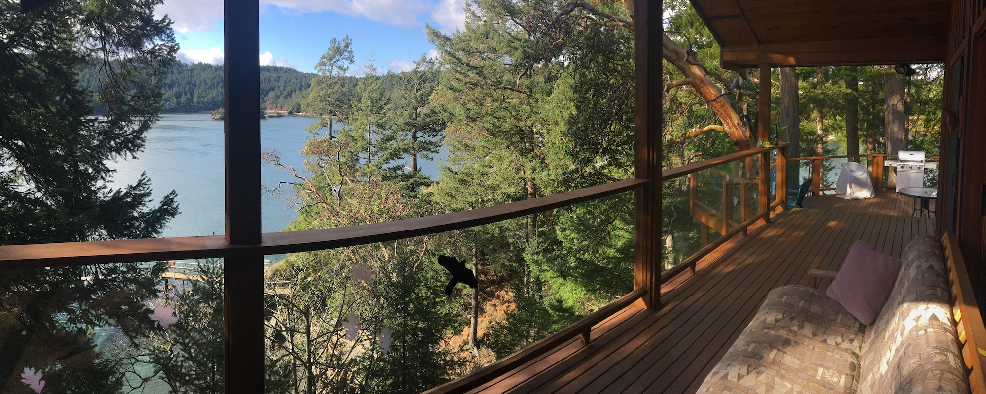 Ainslie Point Cottage vacation rental with ocean views from deck on Pender Island
